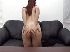 Sexy redhead babe is sucking a juicy dick of a hot interviewer