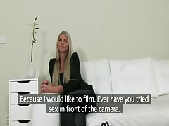 Glamour blonde slowly undressing in the room for Fake Agent