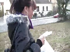 Blowjob by a gorgeous brunette in the street in outdoor porn