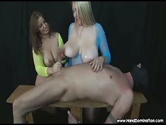 2 girls with huge tits examine a cock during femdom handjob