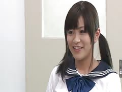 Smiling Japanese beauty posing in front horny students