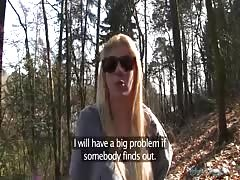 Blonde in sunglasses is staying on her knees and sucking a dick