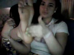 Young girl brushing her feet