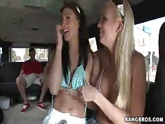 Two busty sluts posing topless in the video by Bangbus