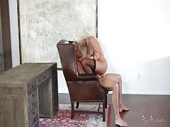 Sensual blonde is wanking his hard dick in the bedroom