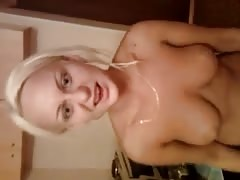 Smiling bleached Russian cutie is demonstrating her naked boobies
