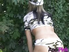 Horny and spicy teen Andi Pink is posing like a stripper outdoor