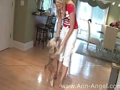 Playful blonde Ann Angel is dancing and showing her enhanced tits