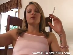 Sweet milf is smoking a cigarette in the video by Alta Smoking
